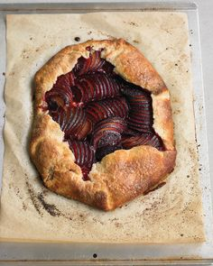 """This appealingly rustic free-form tart is easy to make, even for a novice baker. A layer of toasted almond filling intensifies the flavor of the plums. Buy """"Martha Stewart's New Pies & Tarts"""" Cookbook"""