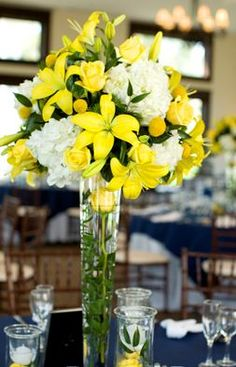 yellow wedding flowers for the table... Yellow asiatic tiger lilies, white stocks