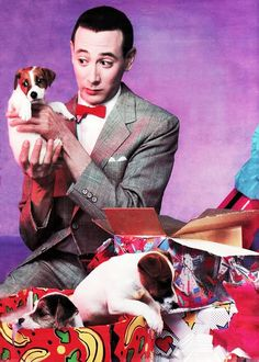 Pee-Wee Herman holding a puppy..