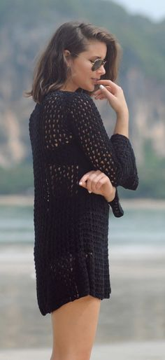 Sara Donaldson is wearing a black crochet cover up top from Cleobella