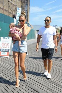 Model Chrissy Teigen and John Legend attend a 'Sports Illustrated' event on Coney Island, New York on August 28, 2016.