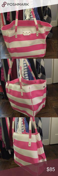 Kate Spade Stripe Leather Tote Pre-owned Kate Spade pink and white stripe leather tote. This bucket tote has a side clasp to cinch the two sides together for some closure. Small makeup spot inside. Otherwise great condition!! kate spade Bags