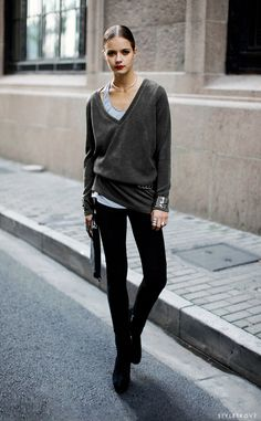 Effortless light grey tank under dark grey vneck slouchy tunic pullover, pitch black jeggings and chunky black boots, hair slicked back with deep red lip