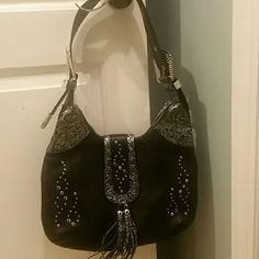 Charm and Luck black shoulder hand bag Charm and Luck should bag with rhinestones on straps and in front. Very stylish. Hardly used. Excellent condition Charm and Luck Bags Shoulder Bags