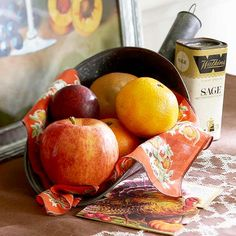 Instead of a cornucopia basket, opt to hold fall bounty in a found object! More creative ideas: http://www.bhg.com/thanksgiving/indoor-decorating/easy-centerpieces-for-thanksgiving/?socsrc=bhgpin102212fruitdisplay