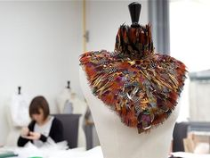 Chanel. Atelier Lemarié. | a beautiful piece from bird feathers | amazing colors | we love color at groovygap.com | #chanelcouture #uniqueaccessory #beautifulfeatherstowear