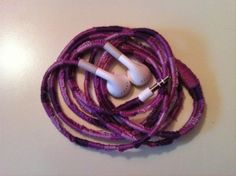 I so want to do this to my earbuds! cover with embroidery floss (knotted the same way as friendship bracelets)