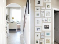 love this wall of pics (from another pinner: love this entry with the floor -to-ceiling framed pictures. blogger says she did it to disguise several  outlets ...