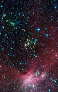 Stars Shoot Jets in Cosmic Playground | Dozens of newborn stars sprouting jets from their dusty cocoons have been spotted in images from NASA's Spitzer Space Telescope. In this view showing a portion of sky near Canis Major, infrared data from Spitzer are green and blue, while longer-wavelength infrared light from NASA's Wide-field Infrared Survey Explorer (WISE) are red.