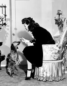 Joan Crawford at home with her friend...