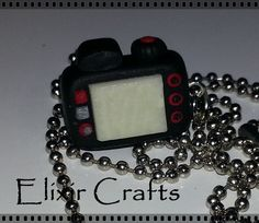 Polymer clay miniature camera necklace by ElixirCraftsGr on Etsy Miniature Camera, Camera Necklace, Polymer Clay Miniatures, Polymer Clay Necklace, Jewerly, Necklaces, Unique Jewelry, Handmade Gifts, Crafts