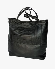 Handmade black leather tote bag, made from parts of an outdated leather jacket. Lined with the canvas from an old military tent. Handmade in New Orleans by Uptown Redesigns. Black Leather Tote Bag, Leather Jacket, Leather Bags Handmade, New Orleans, Handbags, Tent, Military, Canvas, Fashion