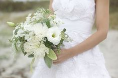 Keep your wedding bouquet classic with gorgeous white or ivory flowers such as white roses, gardenia, ranunculus, lily of the valley, orchids or peonies.