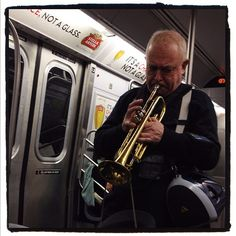 Trumpeter on the F train.