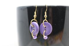 These dangle earrings include a french hook and purple button as well as a purple seed bead all attached with gold jump rings. The earrings come attached to an earring card. **These earrings are NOT nickel free** Button Earrings, Diy Earrings, Earrings Handmade, Handmade Jewelry, Pearl Earrings, Wire Jewelry, Beaded Jewelry, Jewellery, Diy Bracelets Easy