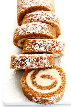 Everything you love about carrot cake...rolled up with cream cheese filling into this delicious Carrot Cake Roll!  Such a fun dessert! | gimmesomeoven.com