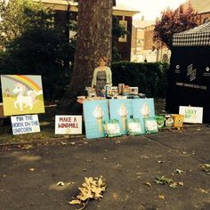 Jordan from our Shoreditch branch at our stall at the Brick Lane Village Fete last weekend! Anyone fancy a game of 'Pin the Horn on the Unicorn'? Pin The Horn On The Unicorn, Village Fete, Brick Lane, Windmill, Horns, Fancy, Game, How To Make, Brick Road
