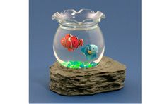 A clown fish and a regal blue tang swim realistically around this mini fish bowl.