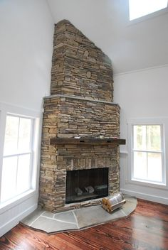 Corner fireplace.- like brick to ceiling!