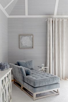 Pale grey velvet settee and grasscloth walls