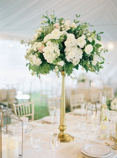 Elegant tall centerpiece: http://www.stylemepretty.com/2016/03/04/classic-romantic-backyard-wedding-in-montana/ | Photography: Rebecca Hollis - http://rebeccahollis.com/