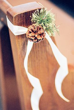 Outdoor wedding reception with church pews sometimes you dont winter wedding pine cone decor love this basic idea with some spring flowers instead junglespirit Image collections