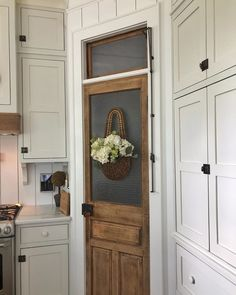 One of my favorite things about my kitchen is this antique door turned pantry door. I just cleaned it up and it was ready to shine again. Pantry Door Storage, Rustic Pantry Door, Built In Pantry, Barn Kitchen, Kitchen Pantry Design, Kitchen Pantry Cabinets, Small Pantry, Kitchen Decor, Screen Door Pantry