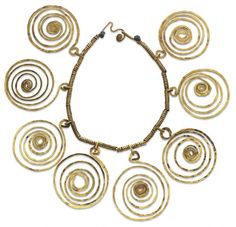 Necklace |  Alexander Calder.    Suspending a series of eight openwork brass spirals, the gray cord neckchain wrapped in brass coils, joined by a brass spiral clasp, circa 1938