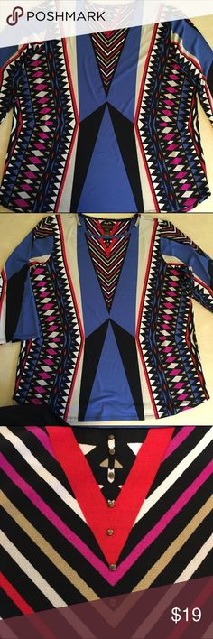 """Geometric Abstract Printed Top Plus Size Top Red Multiples Geometric Aztec Print Top Red, Magenta & Blue mixed with Beige and Black Small Metal Detailing on Center V 3/4 Sleeve Size OX Measures approximately  23.5 across front bustline  18.5"""" Sleeve Length  25.5"""" from Shoulder Seam bottom of shirt Multiples Tops"""