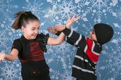 Snowy confetti is a great prop to throw into your winter themed shoots! This photo shows off the Gray Snowflake Printed Backdrop from Backdrop Express.