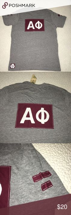 NWT Alpha Phi Heather gray Vneck boyfriend tee NWT Alpha Phi soft Heather gray boyfriend V neck short sleeve tee. Size AM. 50% polyester 38% cotton 12% rayon. Maroon letter logo appliqué on back. Relaxed, loose fit. Solid front. Made in USA. $54 retail. Rare and one of a kind. #greek #life #college #university #alpha #phi #sorority #pledge #gray #maroon #relaxed #soft #big #little #sister #nwt #tee #vneck #fall #football #gameday Never used. Smoke free home. Check closet for similar items…
