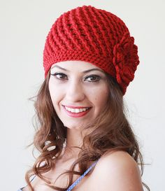 Red beanie hat with flower.
