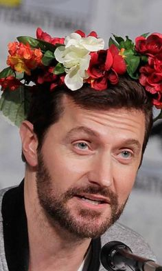 He's cute with the flowers crown