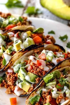 a row of easy turkey tacos on a white cutting board with lettuce, tomatoes, avocados Pork And Beef Recipe, Beef Recipes, Chicken Recipes, Healthy Recipes, Cooking Recipes, Ground Turkey Tacos, Ground Turkey Recipes, Ground Beef, Night Dinner Recipes