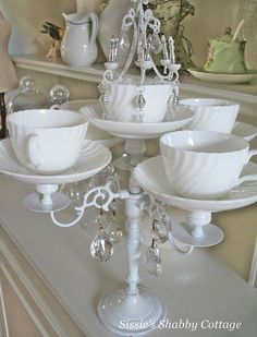 DIY teacup and saucer candelabra! Classy and clever... would be especially fun with an eclectic array of mismatched cups and saucers, don't you think? Find some at www.shopjunket.com