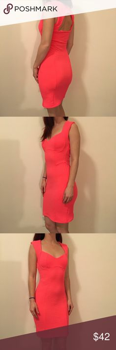 TOPSHOP Neon Textured Bodycon Cut Out Dress TOPSHOP neon orange dress with a textured body and is sleeveless. Cut out in upper back- zipper closure and is a size 6. In great condition. Topshop Dresses Midi