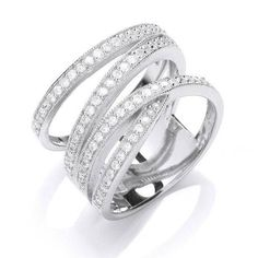 My Little sister asked me for this ring (in white gold) as a little wedding gift and after a lengthy search I found it online. The design was famously created by Cartier and looks really striking. This rhodium plated, silver, four band, crossover, micro pave, Cz' ring is a very reasonable £49.00. What a bargain!....x