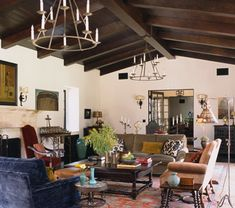 amazing spanish style living room design | LOVE the Ceiling .....Warm white walls, antique rug ...