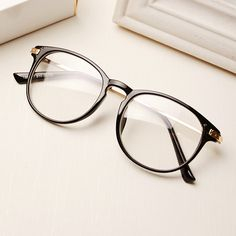 Newest 2015 Men Women Metal Frame Fashion Name Brand Designer Plain Glasses Vintage Reading Eyewear Eyeglass Oculos de grau - http://www.aliexpress.com/item/Newest-2015-Men-Women-Metal-Frame-Fashion-Name-Brand-Designer-Plain-Glasses-Vintage-Reading-Eyewear-Eyeglass-Oculos-de-grau/32292996749.html