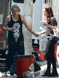 Jamie Campbell Bower and Lily Collins behind the scenes of The Mortal Instruments: City of Bones