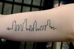 City skyline tattoo....Would be cool if you did the Seattle skyline. Also would look good at your hairline.