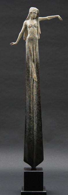 London-based artist Michael James Talbot creates beautiful sculptures of elongated women inspired by Greek mythology and Venetian masquerades in Oxidized Bronze.