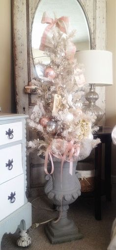 very shabby little tree dressed up for christmas