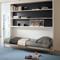 Poppi Book wall bed with added Book Space Saving System consists of a spacious bookcase with 20 linear feet of bookshelves above a twin wall bed. This system is available with an optional fold-out desk mounted on the front of the bed (see Poppi Desk)