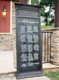 chalkboard seating chart sign note the list is per table alphabetically