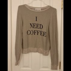 """Wildfox Desperate Mornings Baggy Beach Jumper This top is NWT! It is grey with black lettering on the front. It is very soft. It is approximately 18"""" across the bust when laid flat and 23"""" from shoulder to hem. It is 47% rayon, 47% polyester, 6% spandex. Wildfox Tops"""