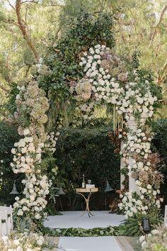 Abundant white floral wedding arbor - Deer Pearl Flowers / http://www.deerpearlflowers.com/wedding-ceremony-decor/abundant-white-floral-wedding-arbor/