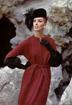 Wilhelmina in an elegant raspberry wool coat belted with sleeves trimmed in black fox by Pierre Cardin, L'Officiel 1962. Photo by Phillippe Pottier.