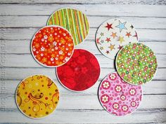 Recycle Craft: CD Coasters - Use CDS to make fabric for bathroom wall, screw in a knob using the center hole
