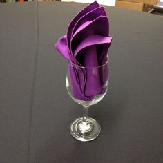 Folded Napkins in Glasses Fan Napkin In Glass — this matte satin plum napkin looks so chic in a wine glass on a wedding dinner table. Matte satin napkins can be purchased or rented from Bright Settings in 38 different colors! With matte sat Christmas Napkin Folding, Paper Napkin Folding, Christmas Napkins, Linen Napkins, Cloth Napkins, Thanksgiving Napkin Folds, Serviettes Roses, Wedding Napkins, Wow Products